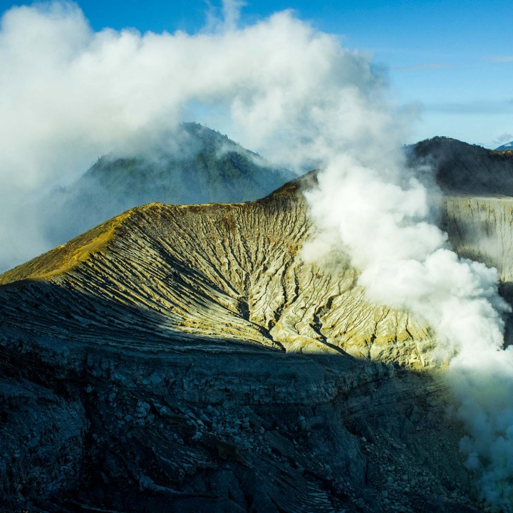 Ijen volcano's crater lake in eastern Java, Indonesia. The mine is located next to the lake, alongside the sulphur vents.