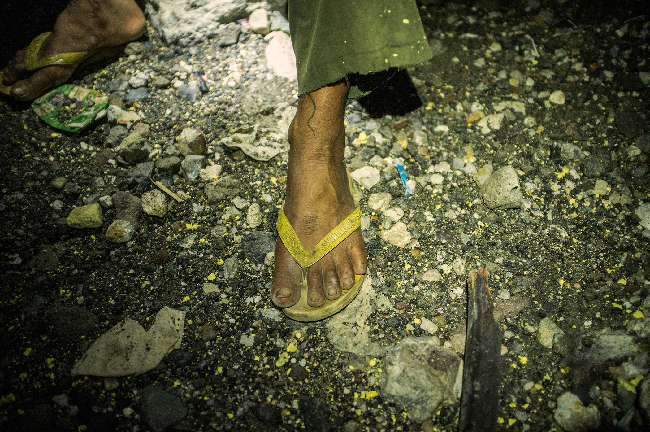 Many miners work without shoes, wearing flip-flops instead.