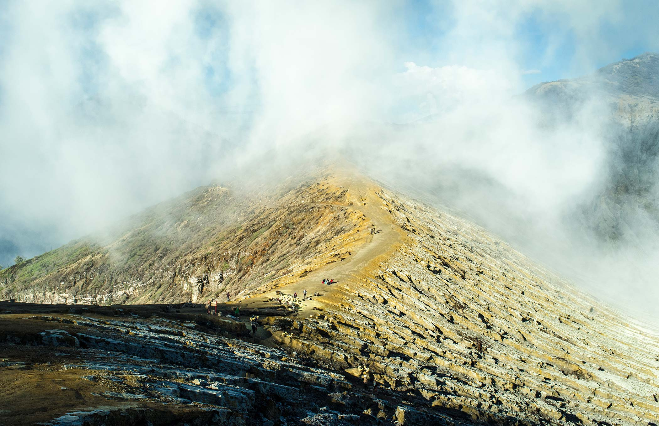 Smoke envelops the crater ridge.