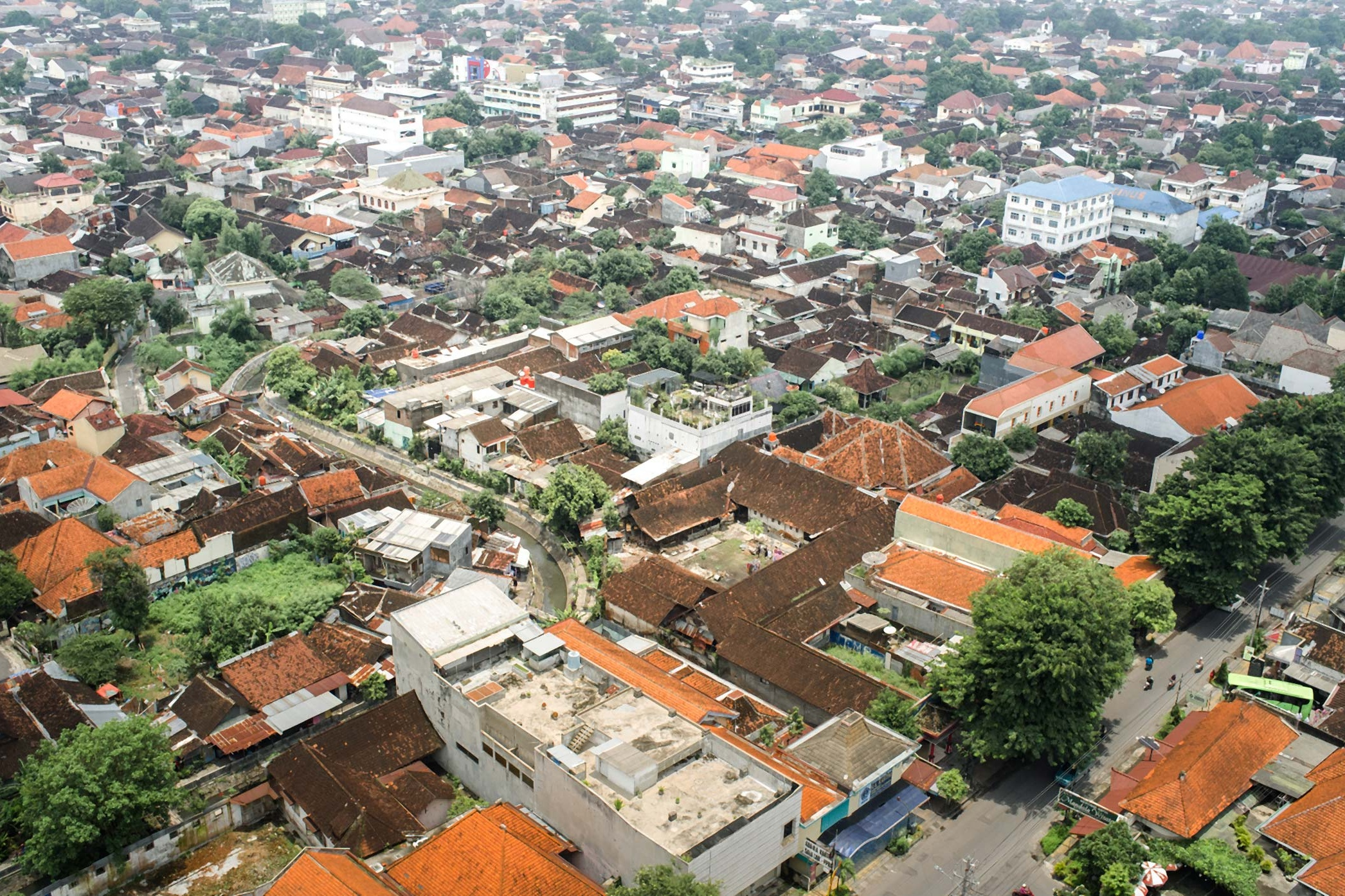 View over the orange rooftops of Surakarta from my hotel.