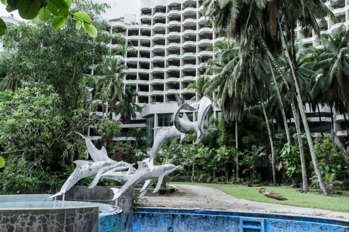 Garden dolphin statues.