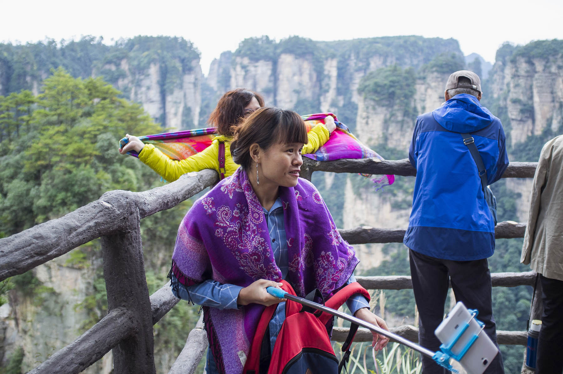 Countless Chinese tourists with selfie sticks.