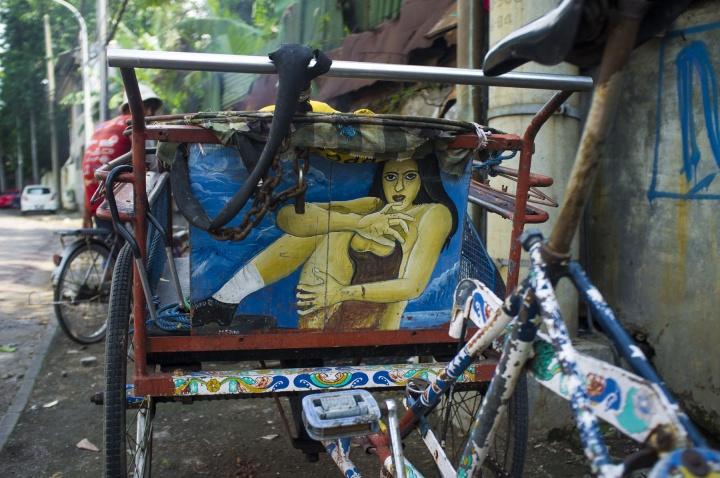 Erotic image of a woman drawn on the back of becak, a rarity in a Muslim country where pornography is banned.