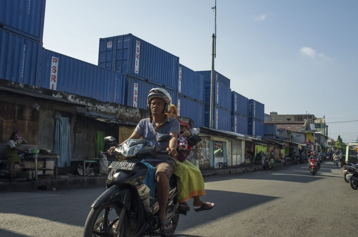 Taking a short cut, the port and stacked containers run through the slums.