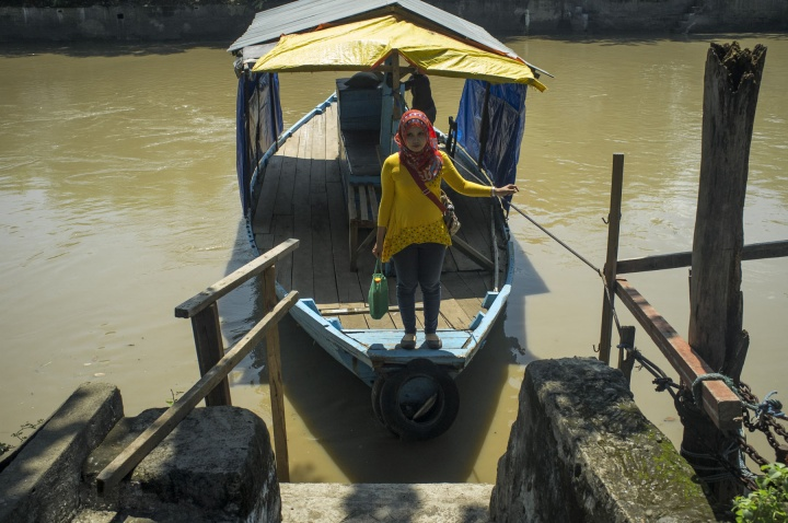 The river has a deficit of bridges, so boats transport people across the river for a small fee.
