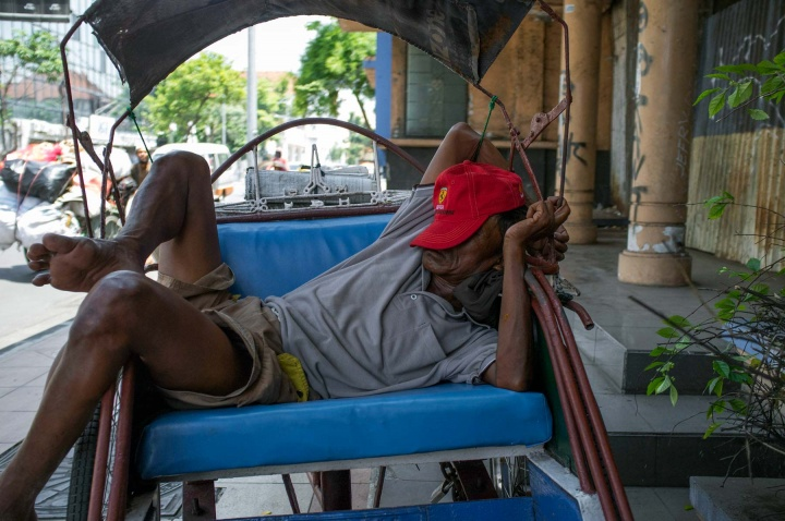 Some becak drivers have no home, so they work most of the time, earning a meager wage and sleeping during the day when temperatures are high.