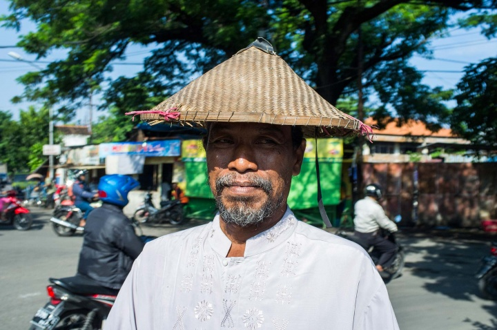 Local man in a conical hat.