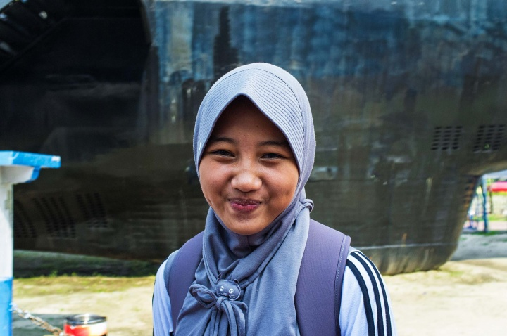Indonesian student in hijab with a peaked front.
