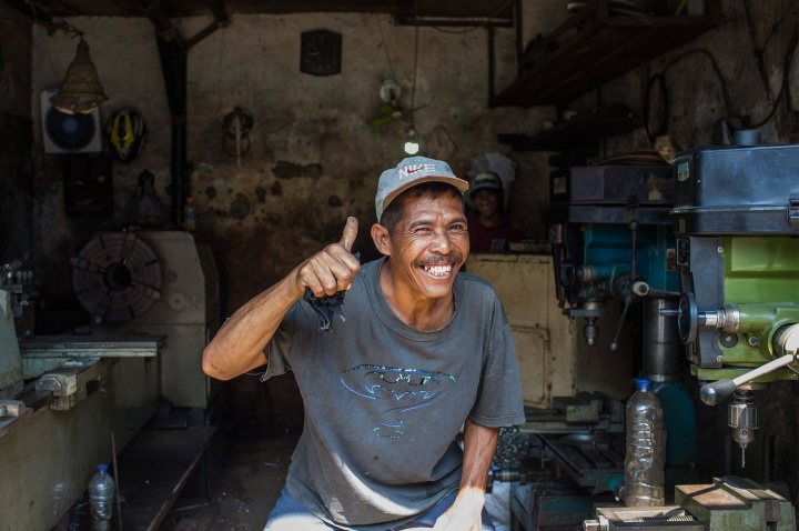 Happy local blacksmith poses for the camera.