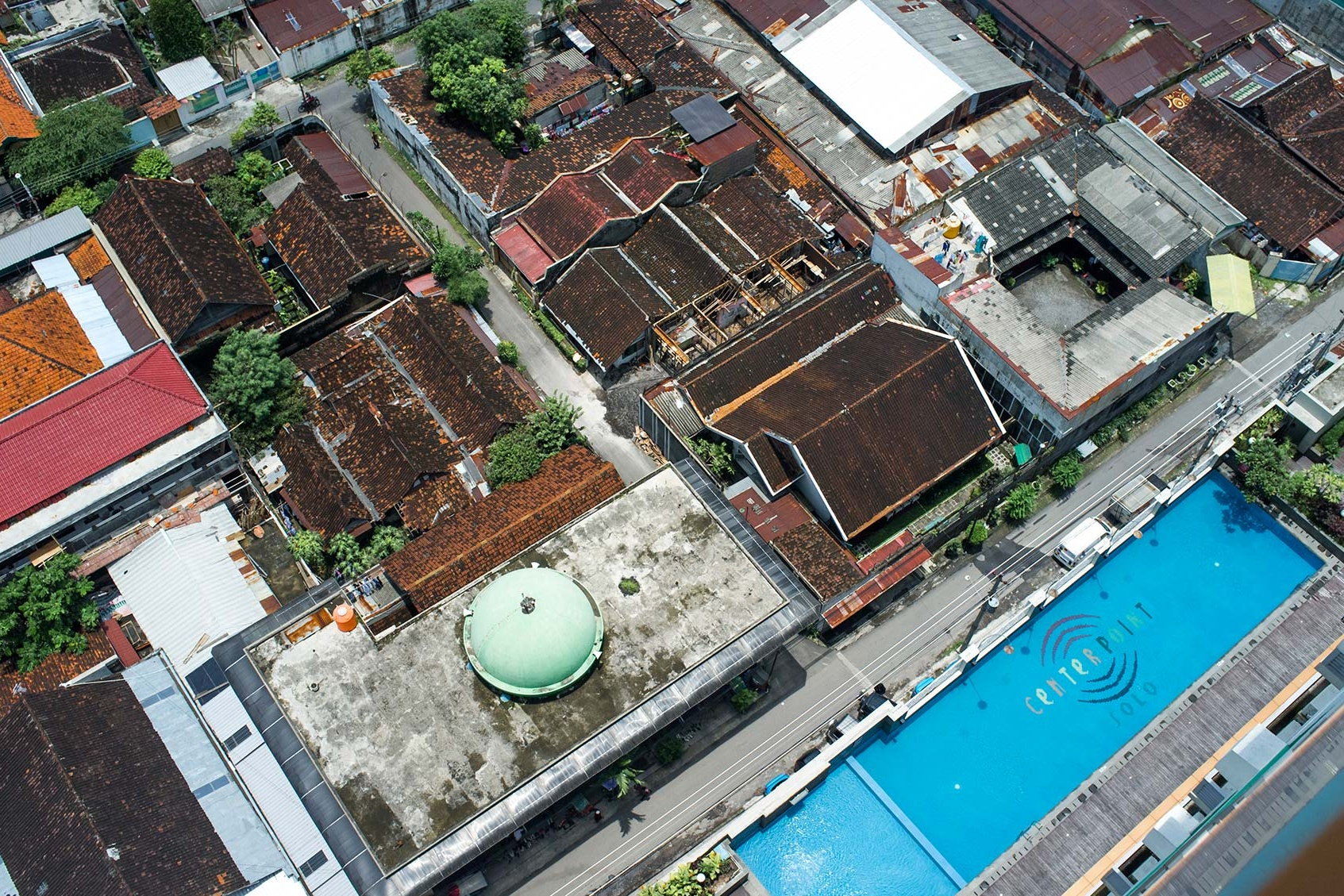 View over orange rooftops of Surakarta from my hotel.