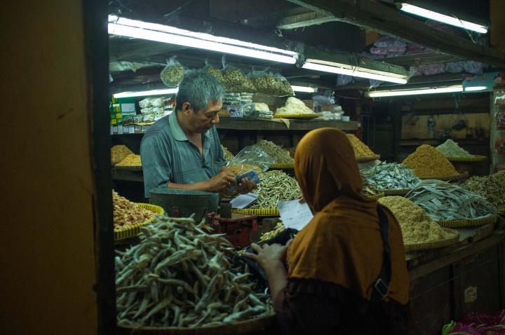 Man selling dried fish inBeringharjo market.