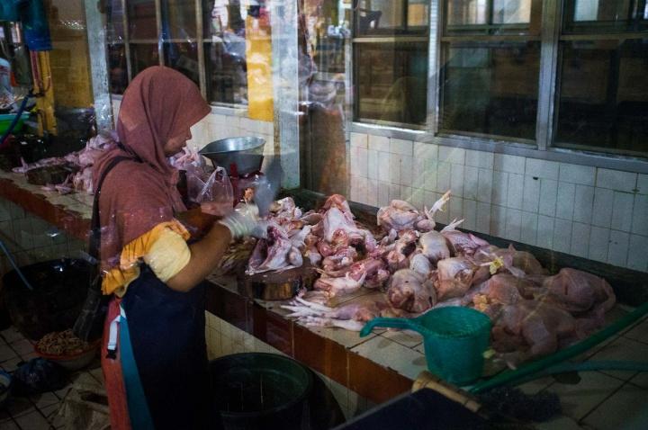 Female butcher in Beringharjo market.