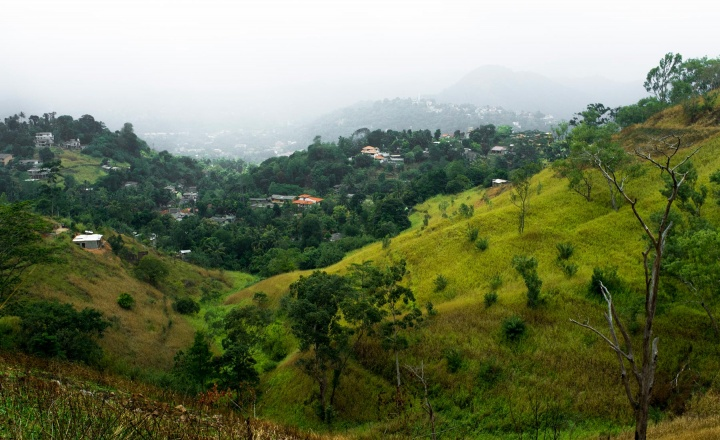 Kandy is located in the middle of the island and surrounded by mountains, where locals cultivate rubber and grow rice.