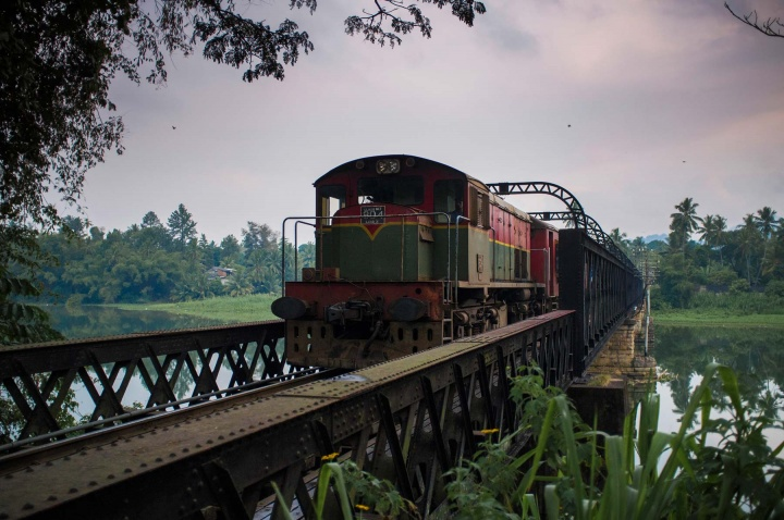 Old British diesel train crossing the river is a remainder from the British colonial time.