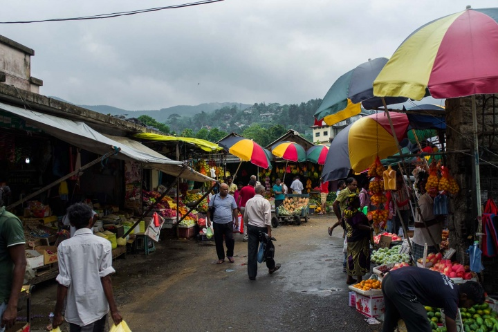 Vegetable market under colourful umbrellas near Kandy bus station.